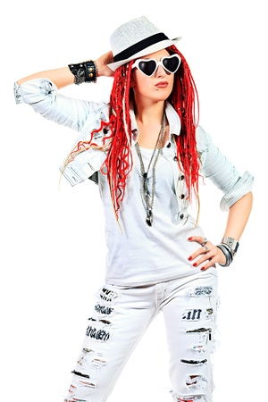 Expressive girl rock singer with great red dreadlocks. Isolated over white.  photo