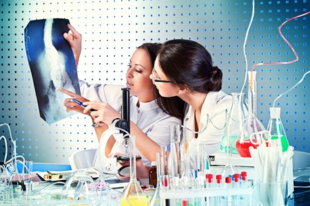 roentgenogram: Surgical staff of the hospital are studying x-ray image. Laboratory equipment. Stock Photo
