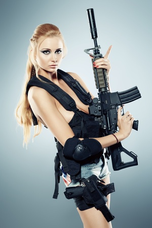 Portrait of a beautiful woman posing in a military style. photo