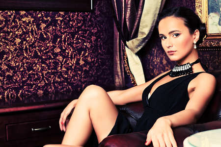 rich people: Beautiful young woman in a  luxurious classic interior.
