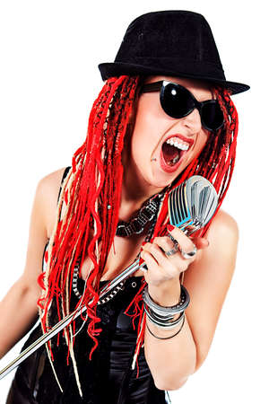 Modern rock singer singing into a microphone. Isolated over white. photo