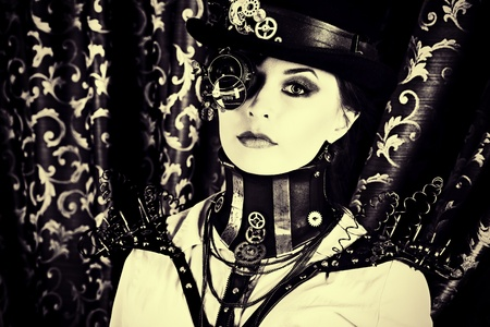 beautiful brunette: Portrait of a beautiful steampunk woman over vintage background. Stock Photo