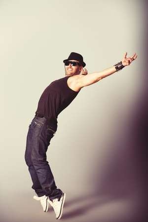 Modern dancer dancing at studio. photo