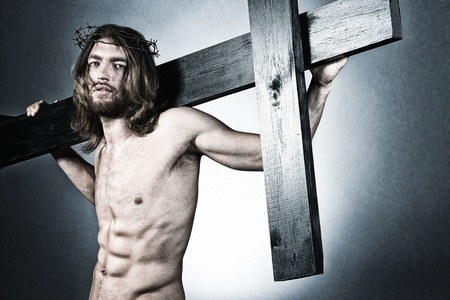 Jesus Christ of Nazareth carrying the cross. photo