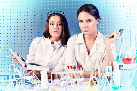 reagents: Laboratory staff in the working process. Laboratory equipment. Stock Photo