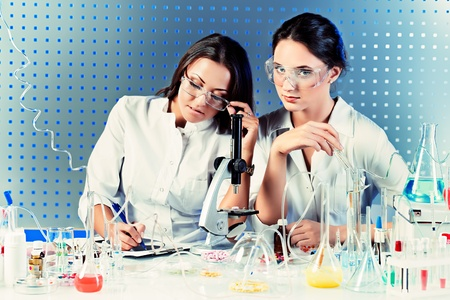 Laboratory staff in the working process. Laboratory equipment. Stock Photo - 21212010