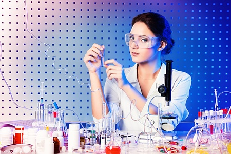 reagents: Employee of the laboratory in the working process. Laboratory equipment.