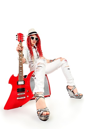 Modern girl rock musician is playing the electric guitar. Isolated over white. Stock Photo - 21212400