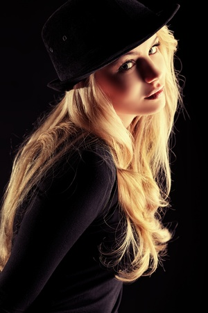 attractive gorgeous: Charming fashion model posing over black background. Stock Photo