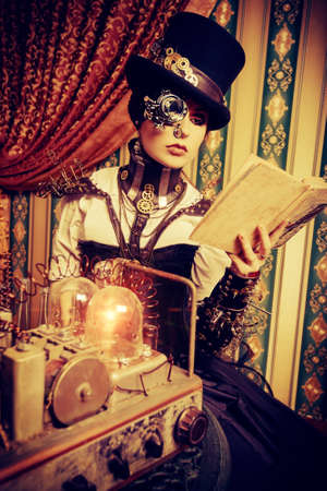 grunge interior: Portrait of a beautiful steampunk woman over vintage background. Stock Photo