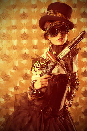 tophat: Portrait of a beautiful steampunk woman holding a gun over vintage background.