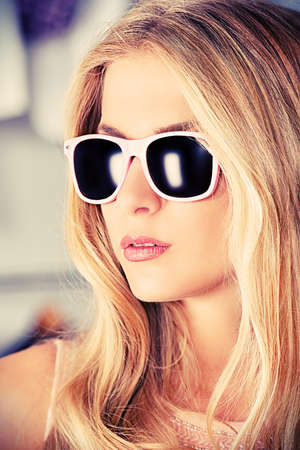 Charming blonde girl in sunglasses. photo