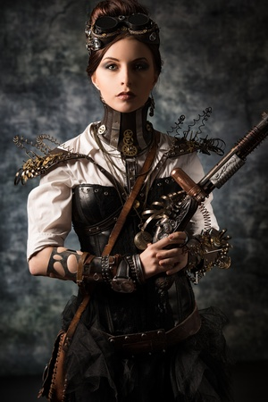 robot girl: Portrait of a beautiful steampunk woman over grunge background.