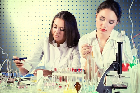 Laboratory staff in the working process. Laboratory equipment. Stock Photo - 21364148