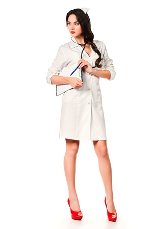 nurse clipboard: Full length portrait of a female medical employee standing with a clipboard. Isolated over white.