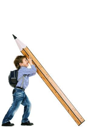 primary education: A boy standing with a huge pencil. Education. Isolated over white.