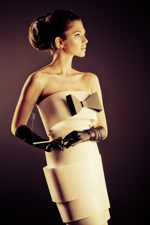attractive gorgeous: Art fashion photo of a gorgeous woman in paper dress. Sepia.