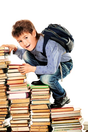 hard way: A boy climbing the stairs of books. Education. Isolated over white.