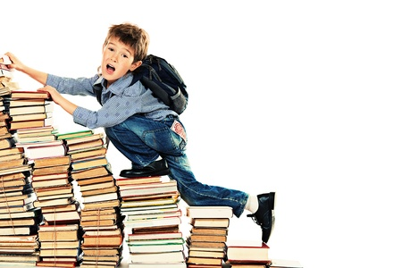 A boy climbing the stairs of books. Education. Isolated over white. photo