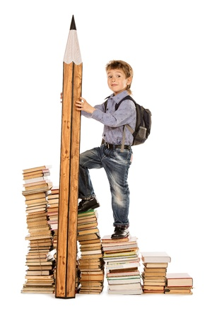 schoolbag: A boy climbing the stairs of books with a huge pencil. Education. Isolated over white.