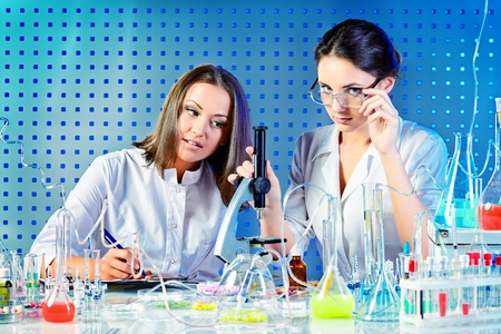 Laboratory staff in the working process. Laboratory equipment. photo