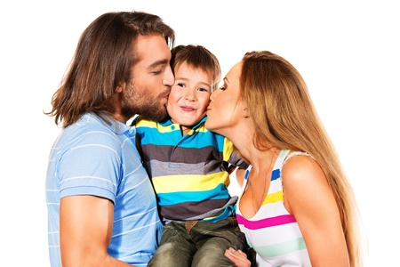 Portrait of a happy family. Father, mother kissing their son. Isolated over white. photo