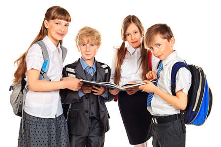 school children uniform: Group of school boys and girls standing together and reading a book. Education. Isolated over white background.