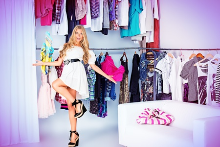 boutique shop: Fashionable young woman shopping in a clothing store. Stock Photo