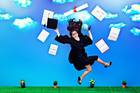 Happy graduate student is flying in the sky with her diploma and books. photo