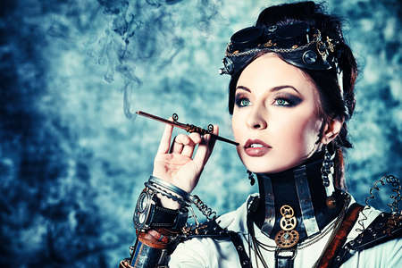 victorian girl: Portrait of a beautiful steampunk woman over grunge background.