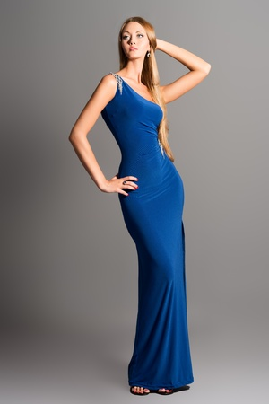 Full length portrait of a fashionable model in an evening dress. photo