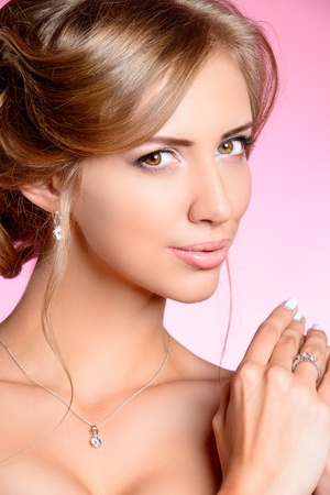 Portrait of a beautiful bride, sweet and sensual. Over pink background. Stock Photo - 21774306
