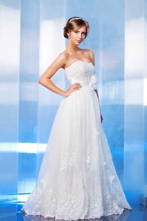 Full length portrait of a beautiful bride, sweet and sensual. Stock Photo - 21774336