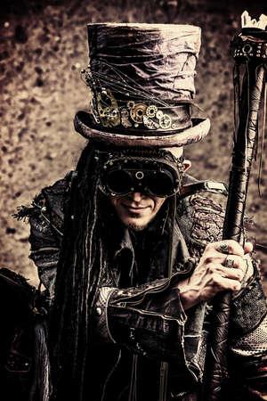 gothic: Portrait of a steampunk man over grunge background.