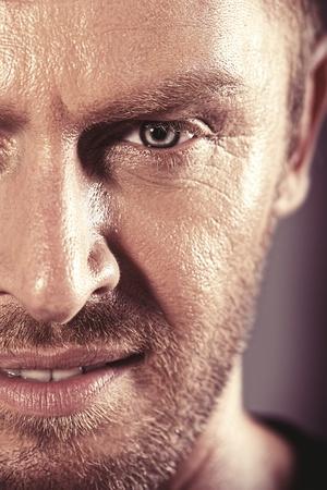 manly man: Close-up portrait of a handsome mature man.