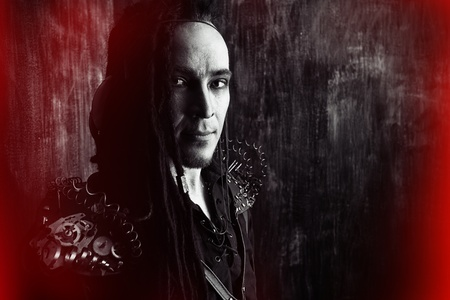 Gothic style: Portrait of a steampunk man over grunge background.