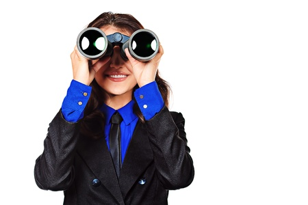 executive affable: Portrait of a smiling woman in a suit looking in the binoculars. Isolated over white. Stock Photo