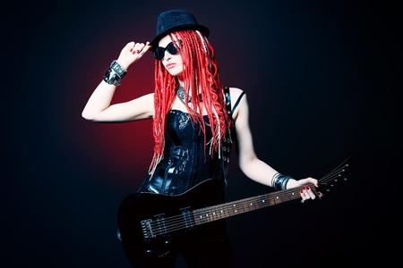 woman guitar: Modern girl rock musician is playing the electric guitar.  Stock Photo