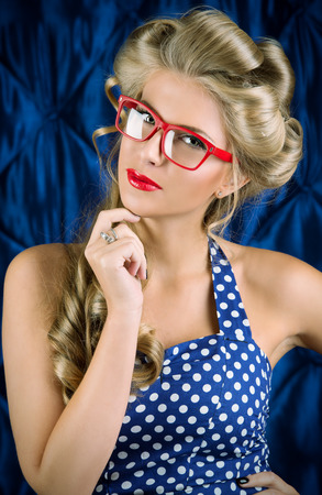 Charming pin-up woman with retro hairstyle and make-up  photo
