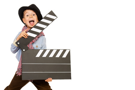 clapper: Cheerful boy holding clapper board. Different occupations. Isolated over white. Stock Photo