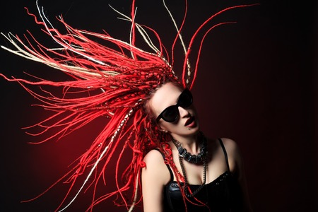 Portrait of expressive girl with great red dreadlocks. Stock Photo - 22400392