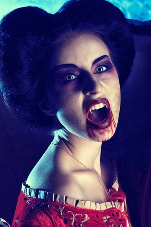 godforsaken: Close-up portrait of a bloodthirsty female vampire. Stock Photo
