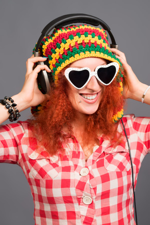 Portrait of a cheerful girl listening to music in headphones. photo