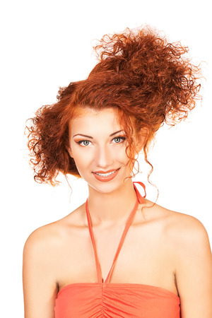 Cheerful young woman with beautiful red curly hair. Isolated over white. Stock Photo - 22484790