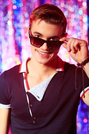 Modern young man at the night party. Disco lights. Stock Photo - 22578333
