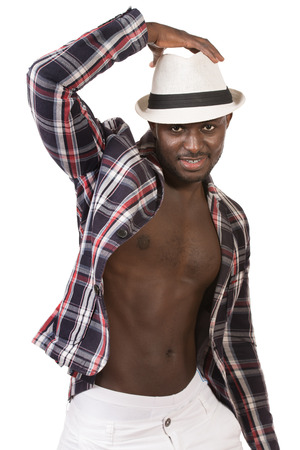 Modern african american young man dancing at studio. Isolated over white. photo