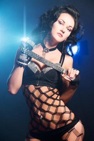 Sexual brunette girl dancing at nightclub. Stock Photo - 22578342