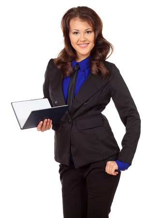communicable: Portrait of a smiling business woman with a diary. Isolated over white. Stock Photo