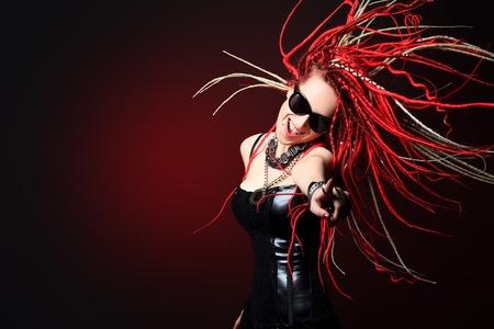 dreadlock: Portrait of expressive girl with great red dreadlocks.