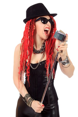 modern rock: Modern rock singer singing into a microphone. Isolated over white.